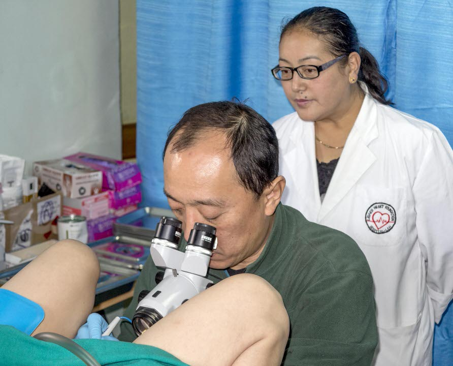 Dr Quek performing a LEEP on one of the patients while training Dr Dekyi in the relatively simple, but effective technique
